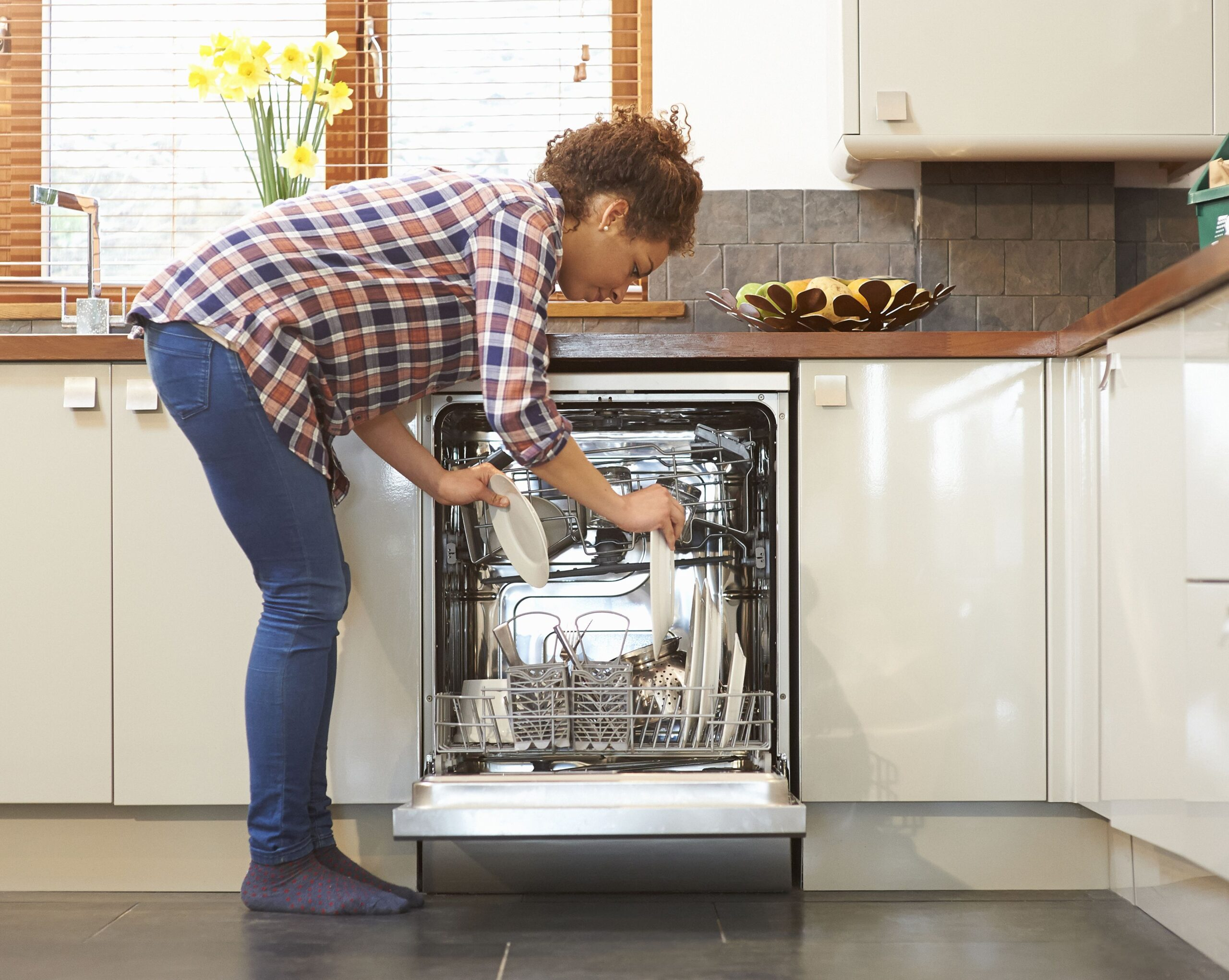 woman unloading dish washer in kitchen 483712233 59ef8ea2c412440011c9b681 scaled
